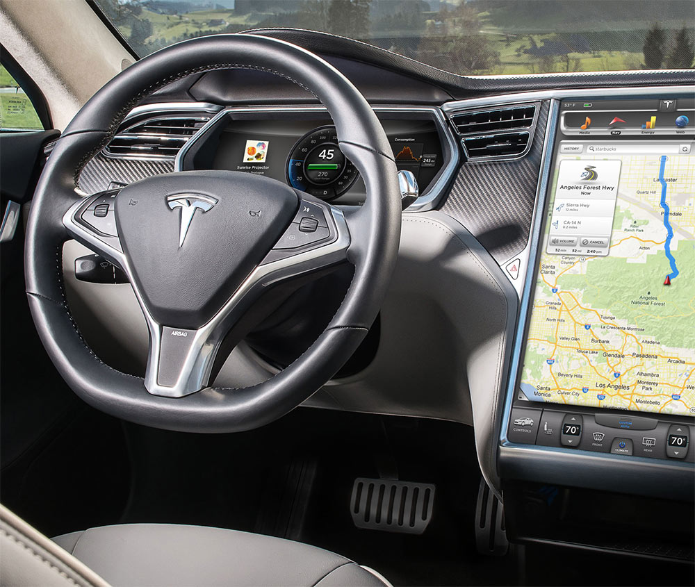 the tesla motors logo is a cross section of an electric motor. Black Bedroom Furniture Sets. Home Design Ideas