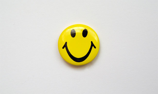 Smiley pin badge