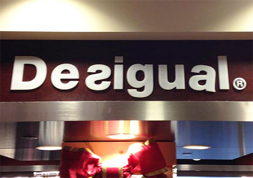 desigual-signage-airport Desigual, butchered design tips