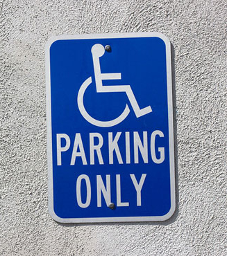 Wheelchair parking only sign